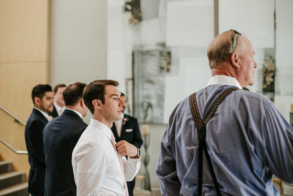 Groom and groomsmen leaving hotel