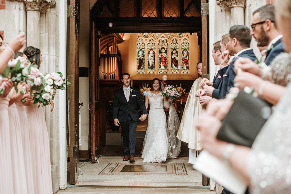 Bride and groom leaving wedding again