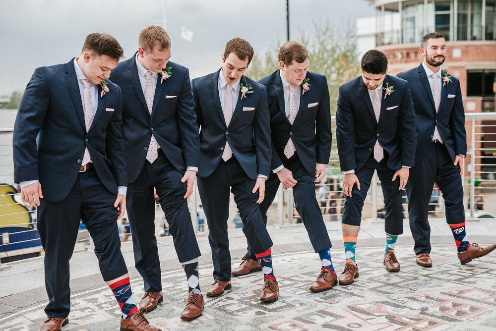 Groomsmen showing off socks