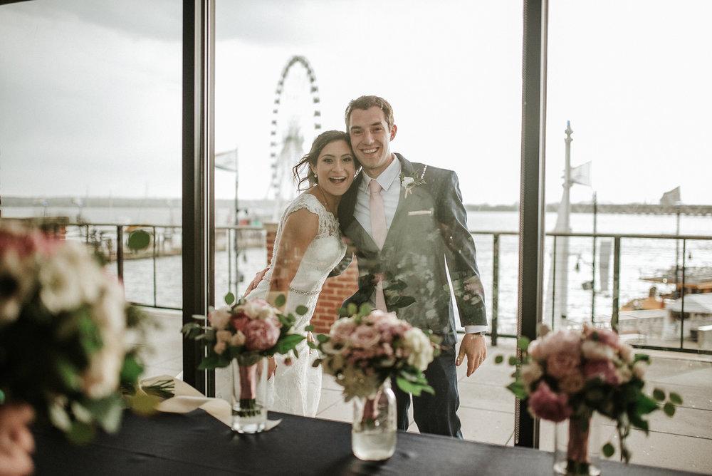 Bride and groom looking through window
