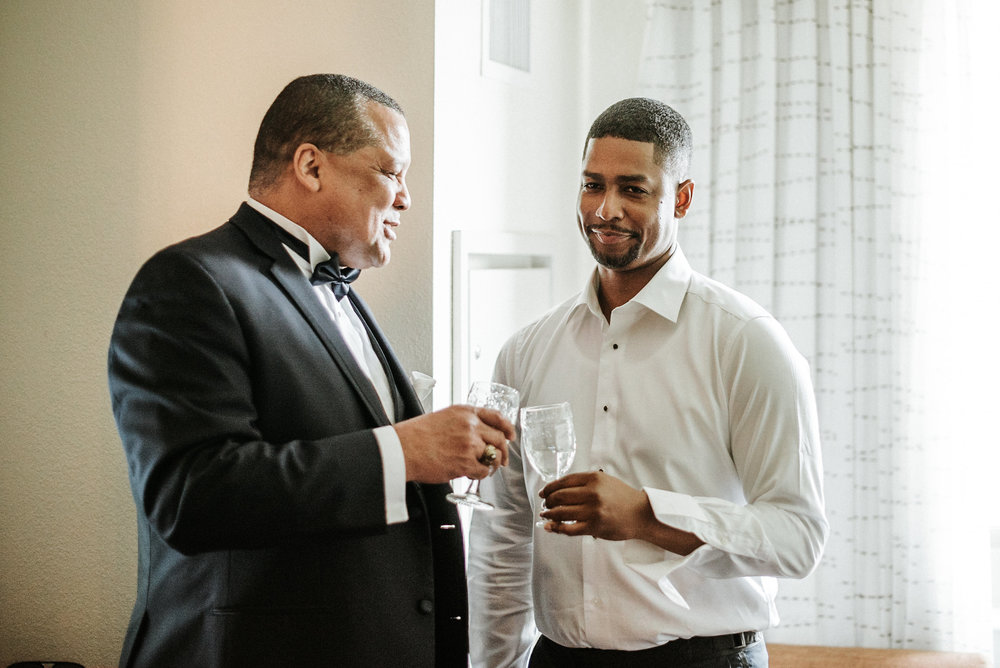 Groom sharing a drink
