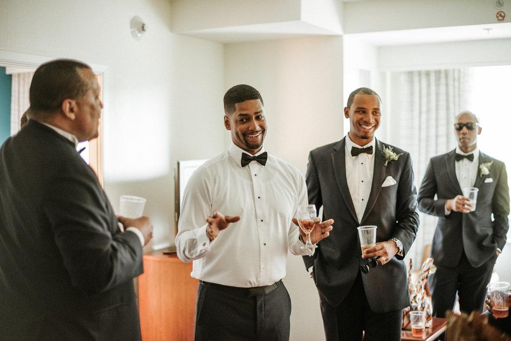 Groom drinking with groomsmen