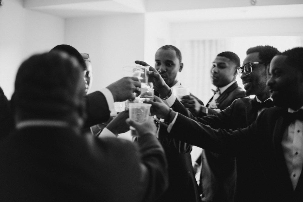 Groomsmen making a toast