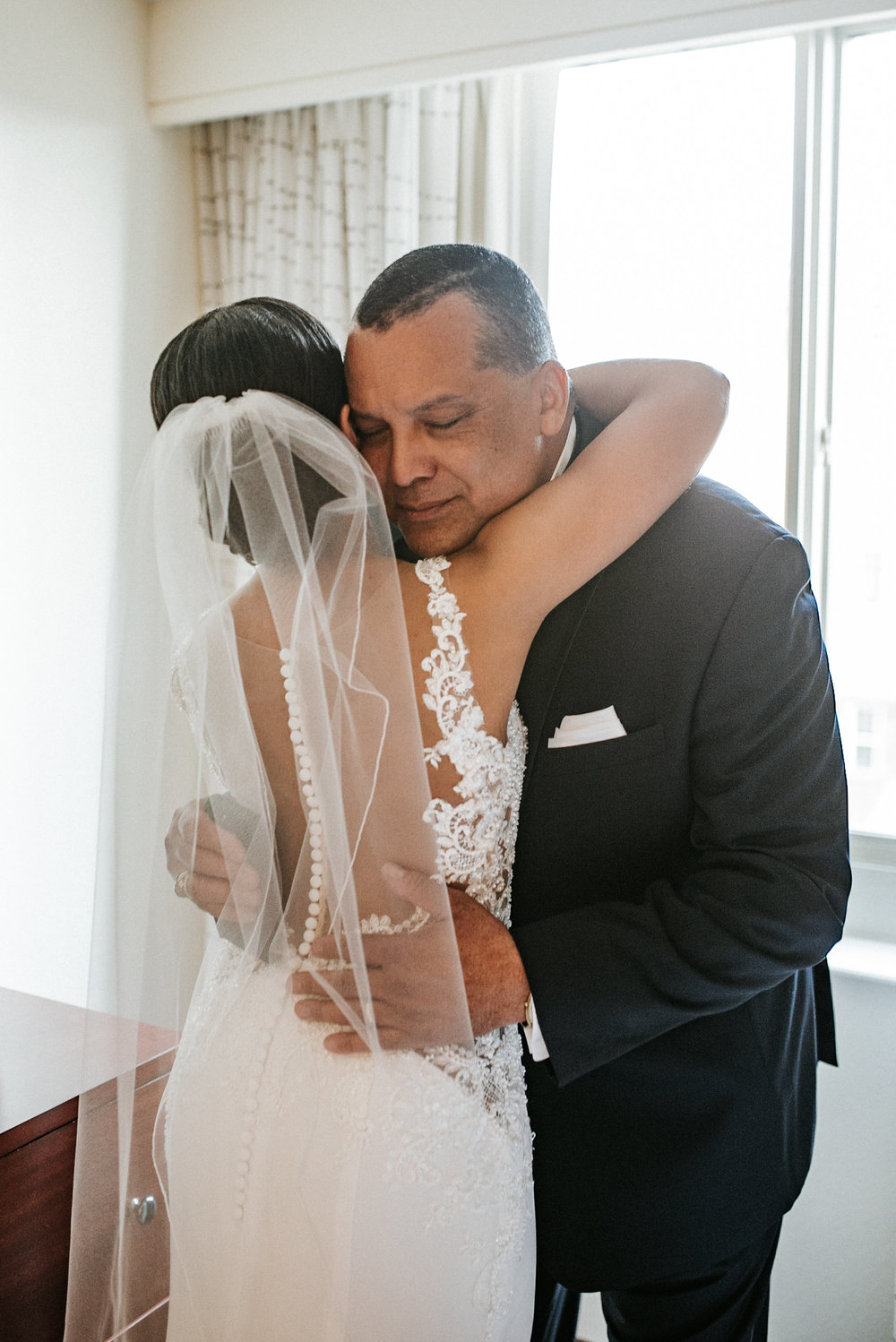 Bride and father hugging