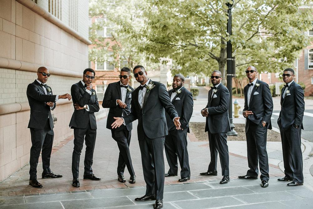 Groom and groomsmen posing