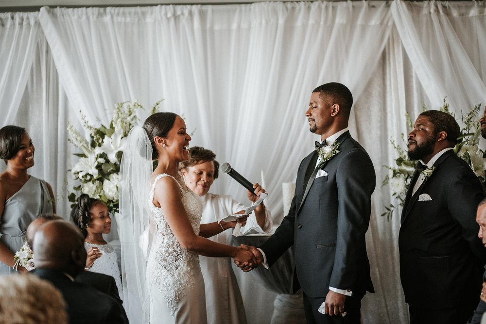 Bride reciting vows during ceremony