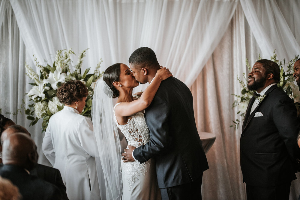 Bride and groom kissing during wedding