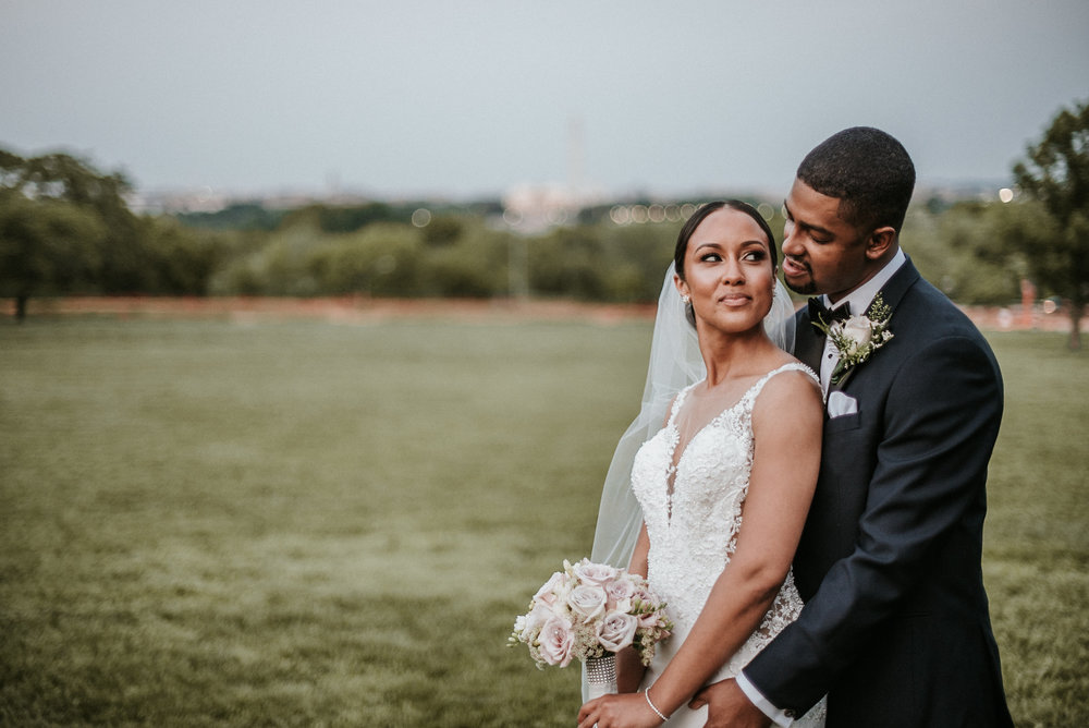 Bride looking at groom over shoulder