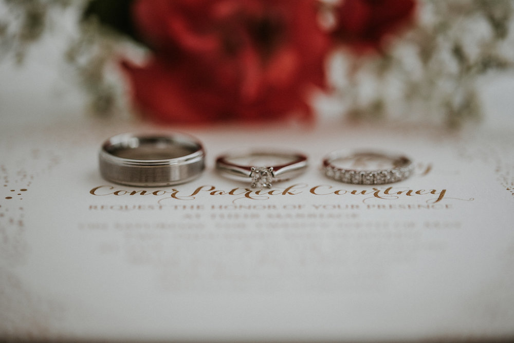 Invitation with rings and roses