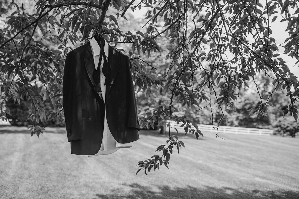 Black and white photo of groom's suit