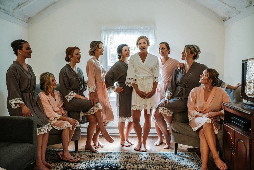 Bride surrounded by bridesmaids in robes