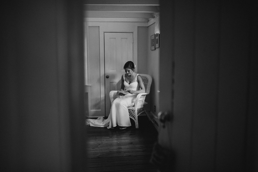Bride in black and white in chair