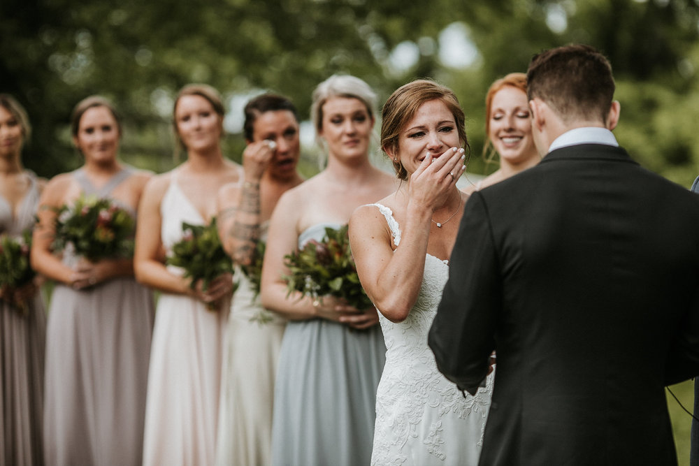 Bride laughing during vows