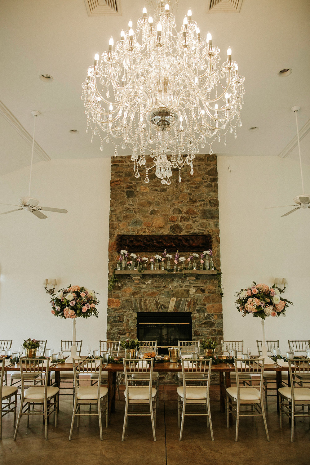 Chandelier over bridal table