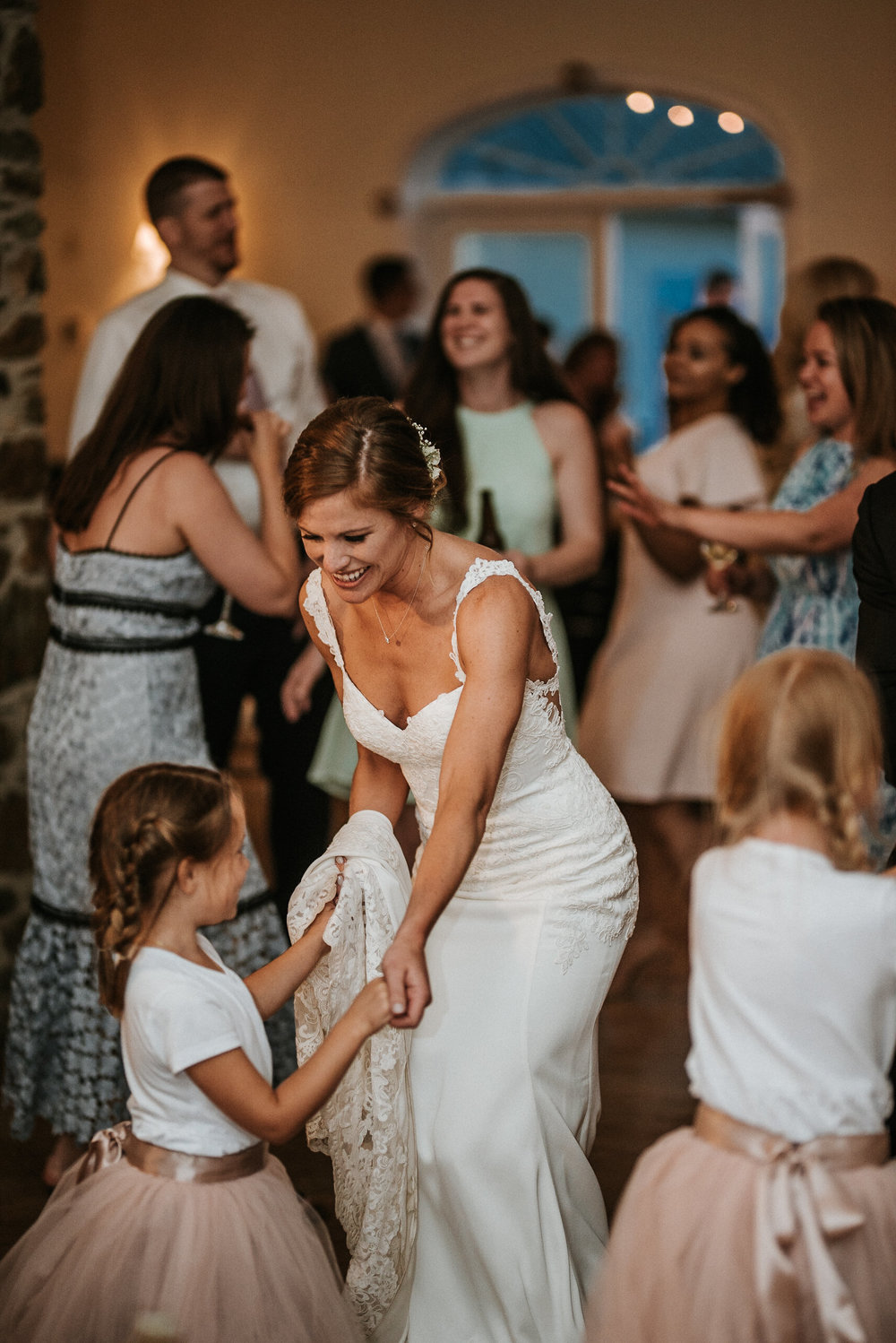 Bride dancing with flower girls