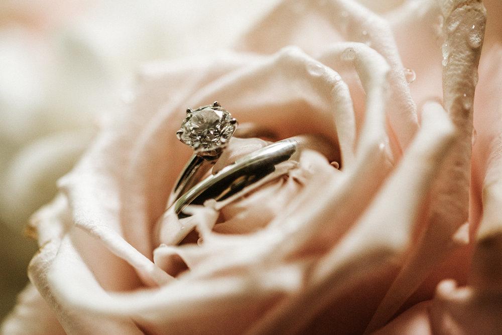 Wedding ring inside pink rose