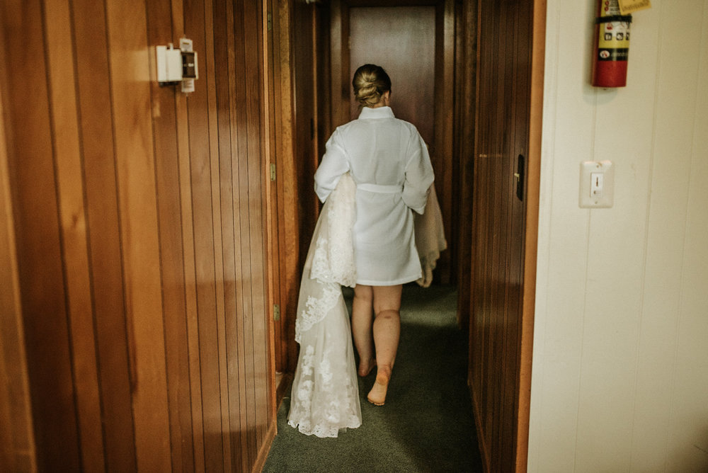 Bride going to put on wedding dress