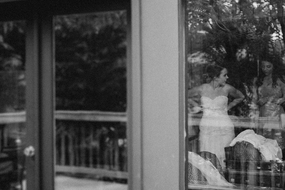 Bride seen getting ready through window