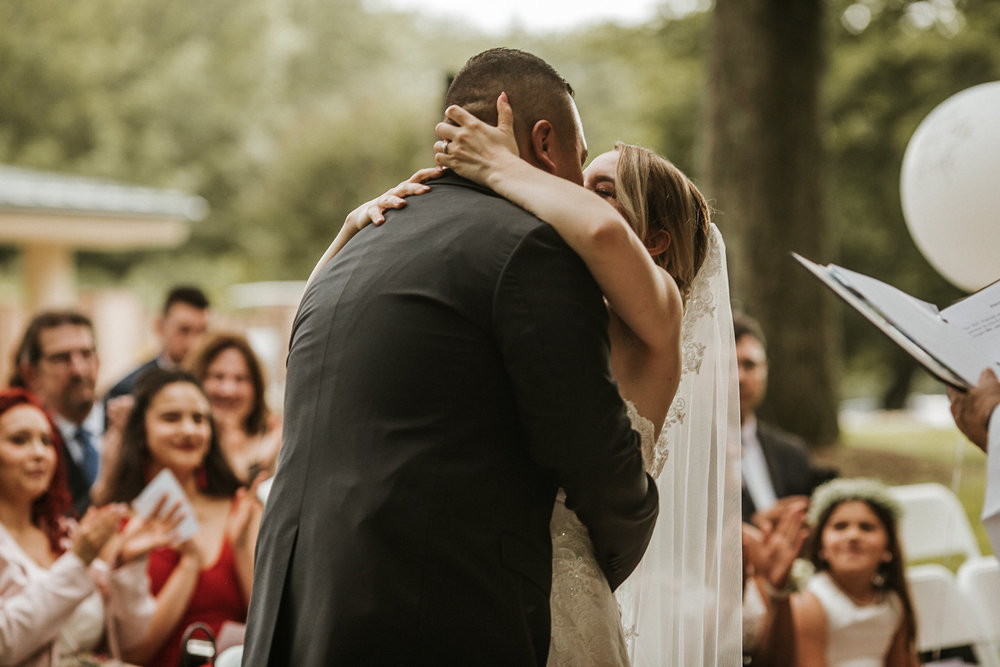 Bride kissing groom at wedding