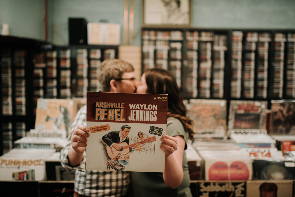 Couple holding up record and kissing