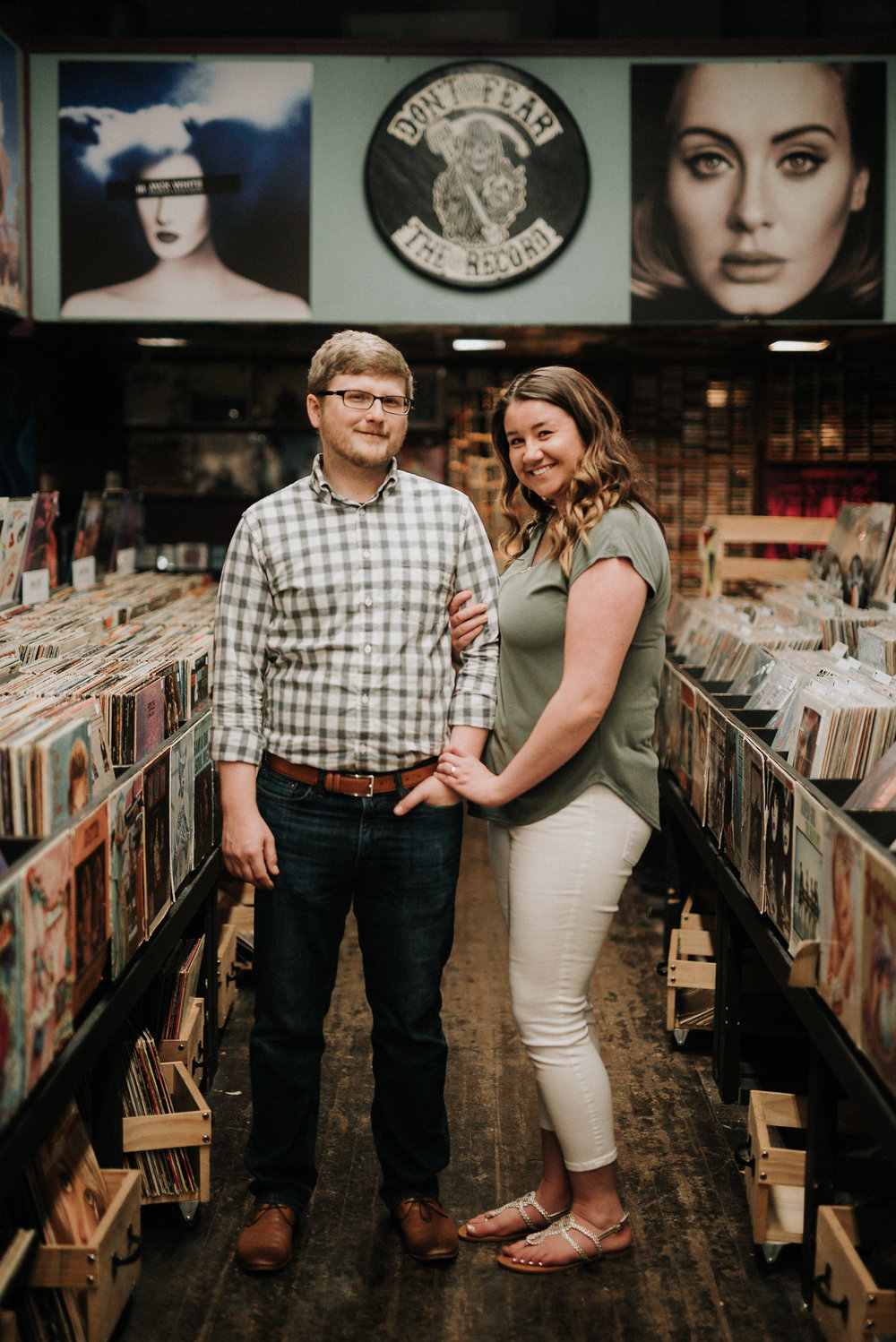 Couple standing in the middle of record store