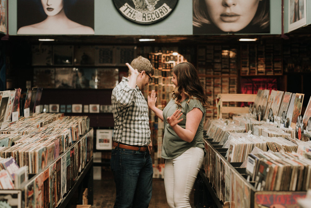 Couple dancing in record store