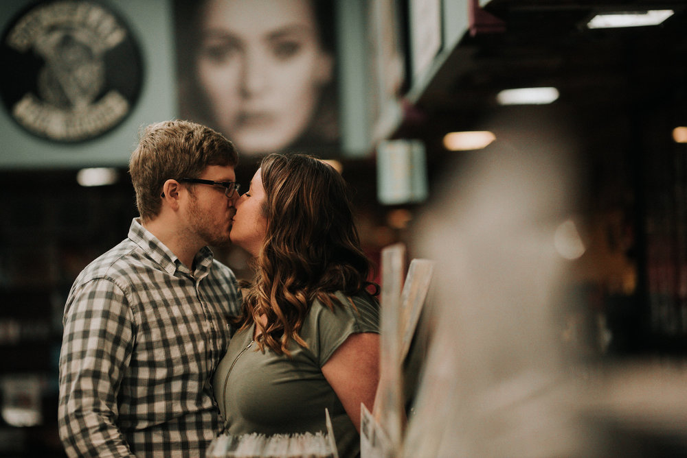 Couple kissing in record store
