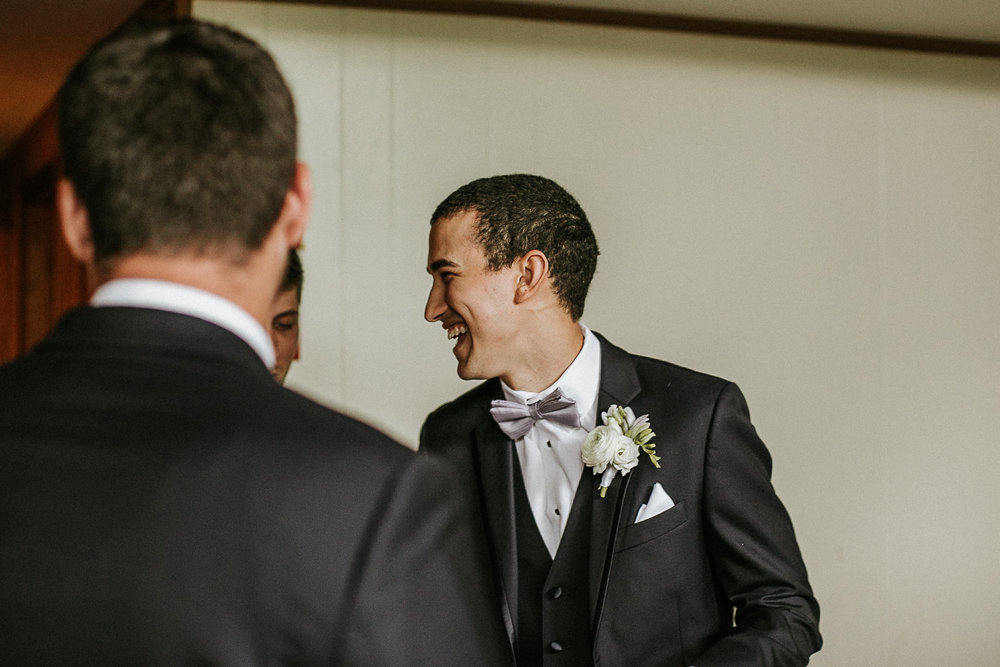 Groom laughing before wedding