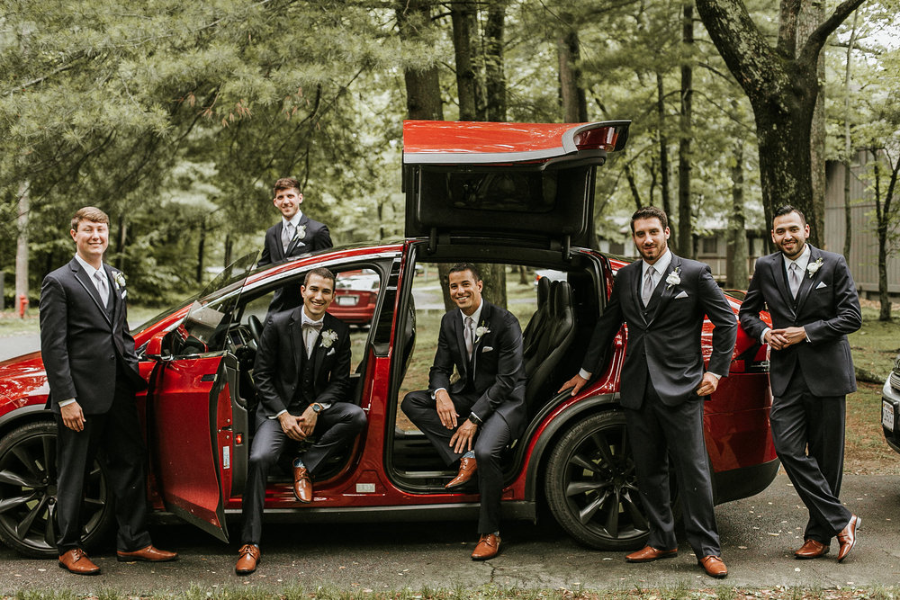 Groomsmen around Tesla
