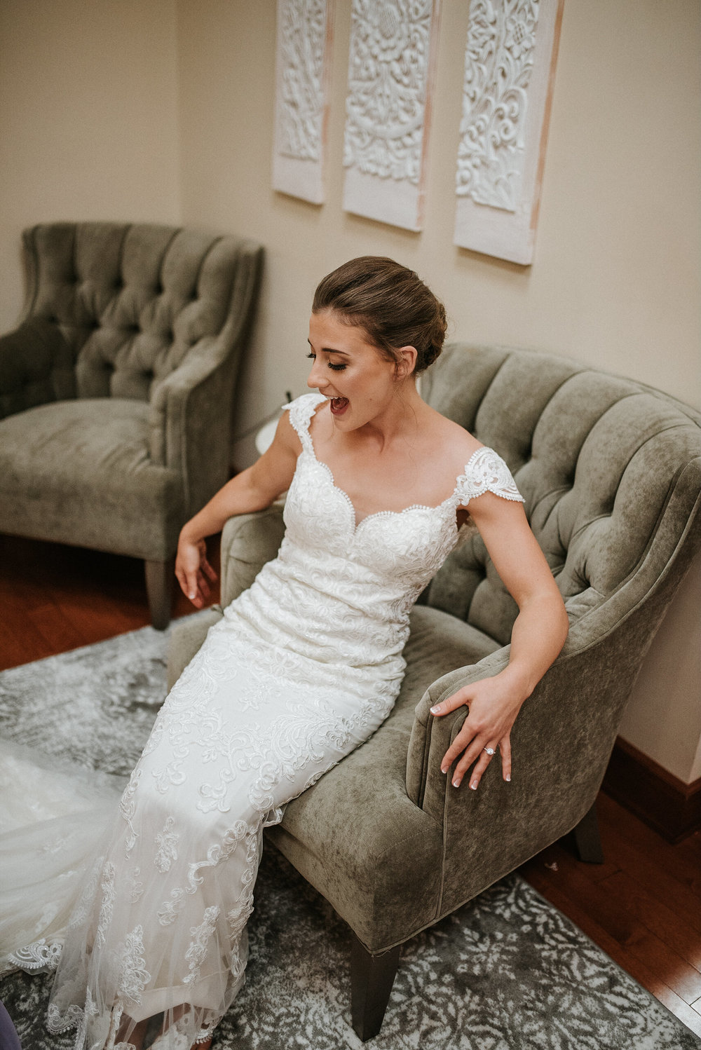 Bride sitting in velvet armchair