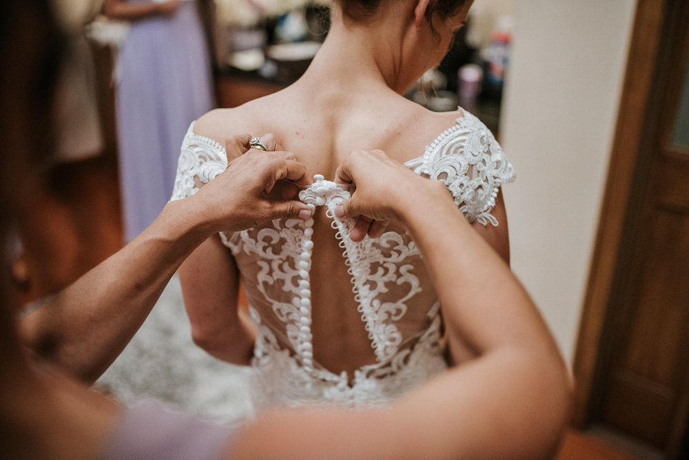 Buttons on back of brides dress