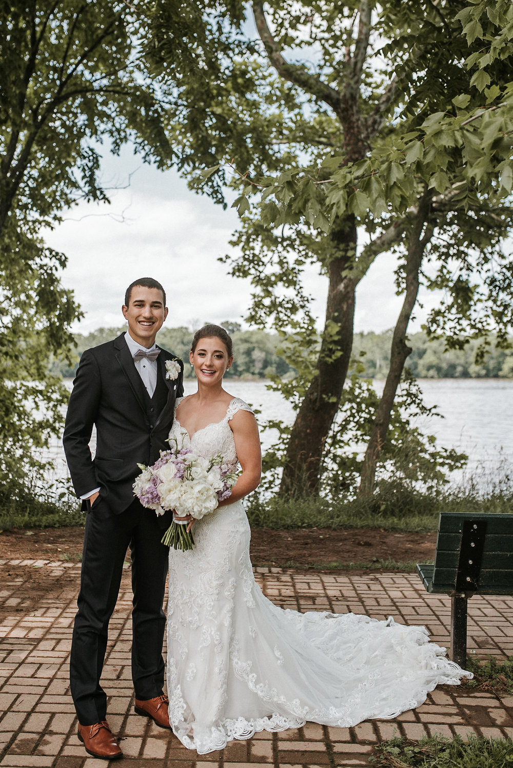 Bride and groom in front of lake