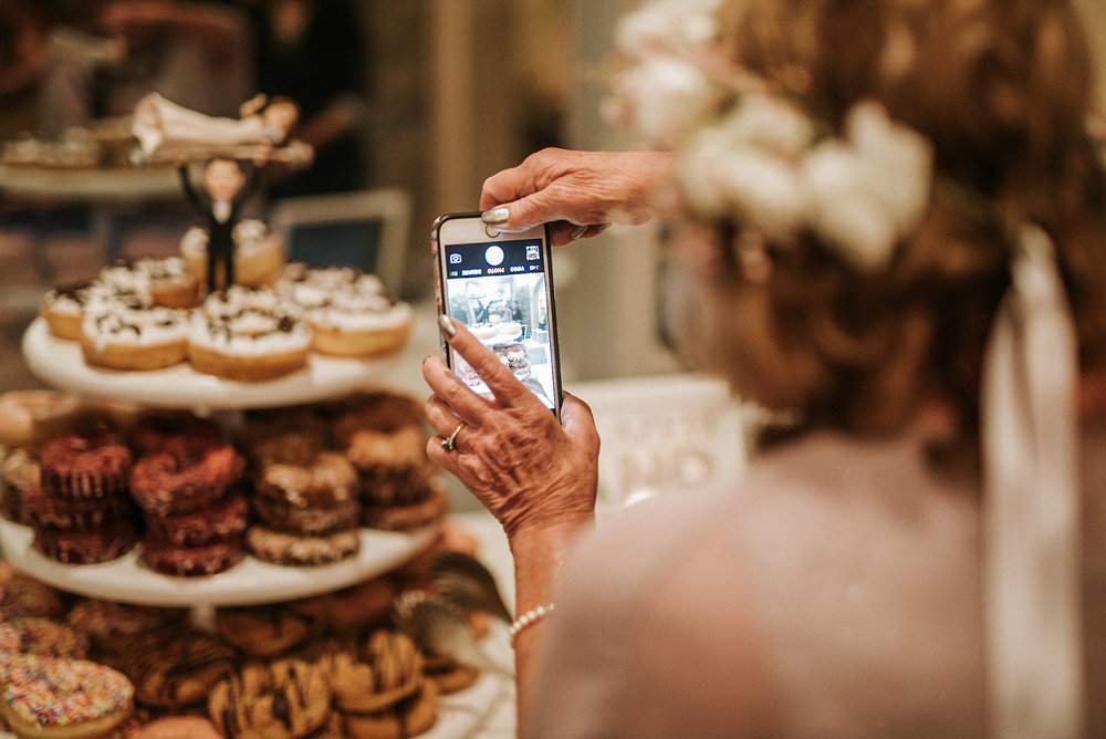 Guest photographing a donut cake