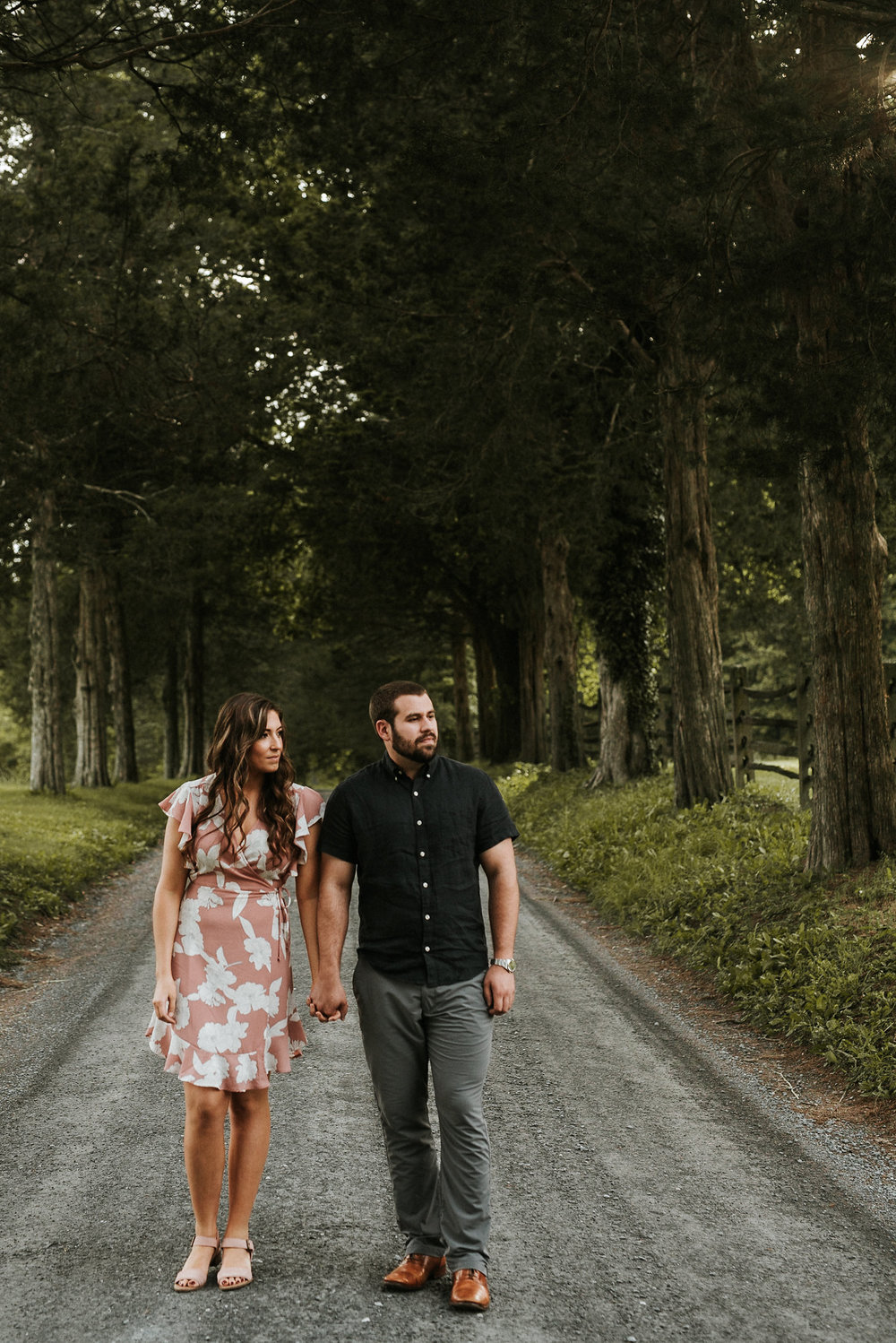 Couple standing in road and looking into distance