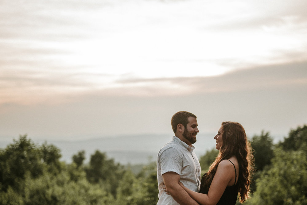 Couple with mountain sunset behind