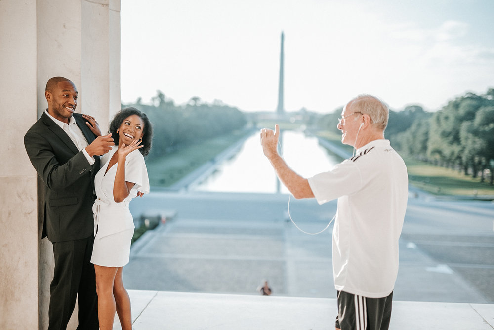 Jogger taking a photo of couple