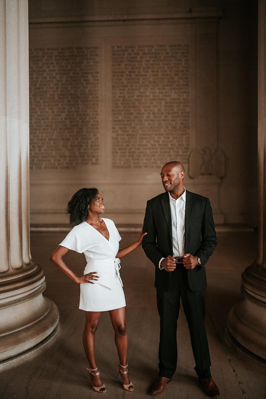 Couple standing between columns