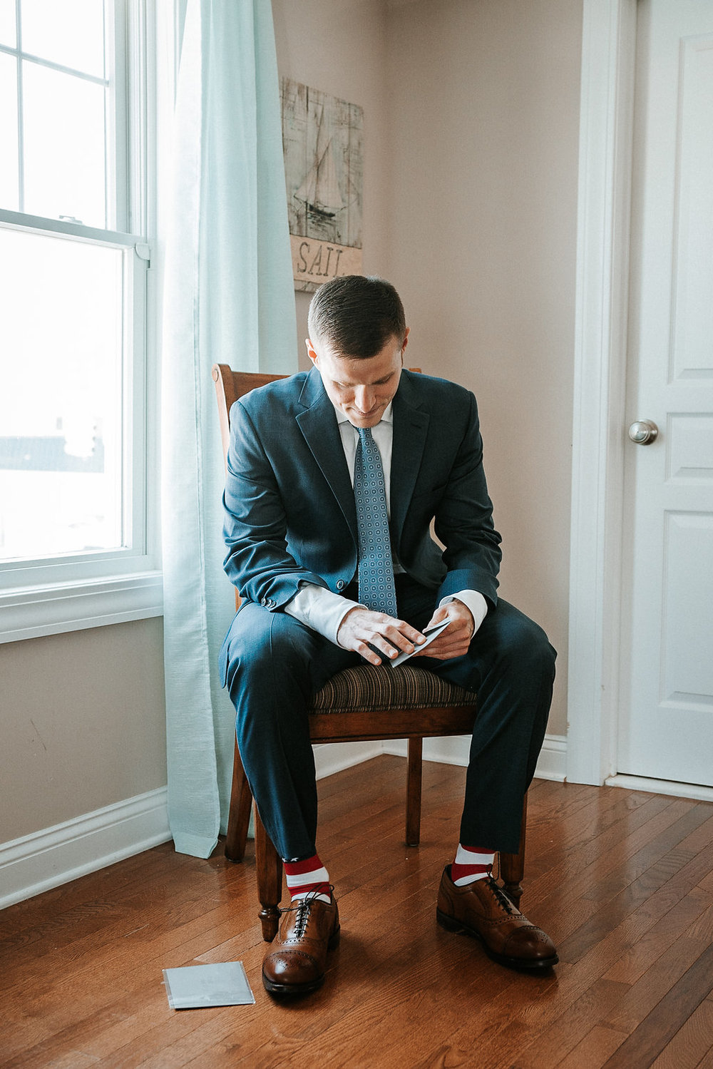 Groom Reading Letters from his Bride at Crystal Point Yacht Club