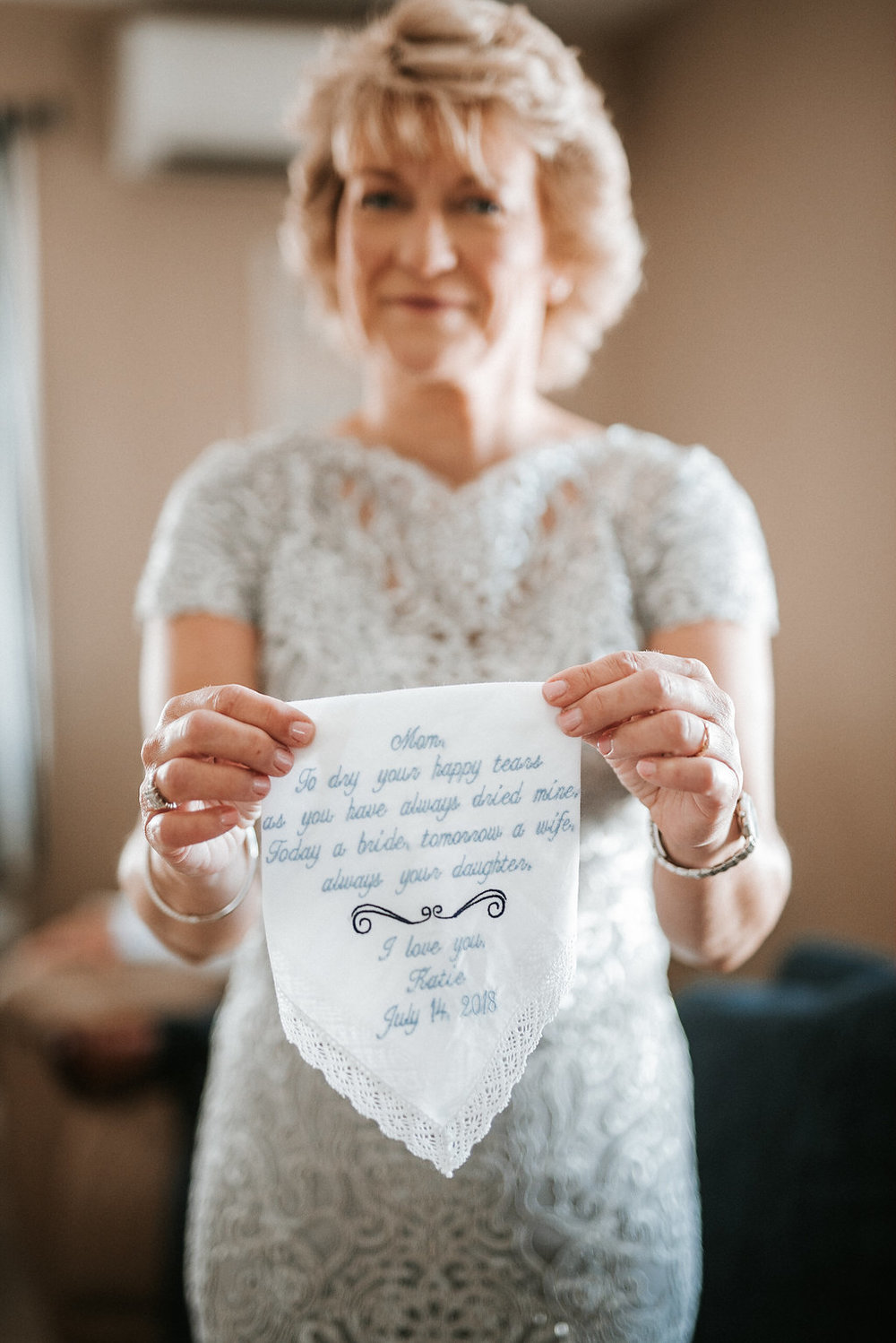 Mother of the Bride Holding Embroidered Gift from Daughter at Crystal Point Yacht Club
