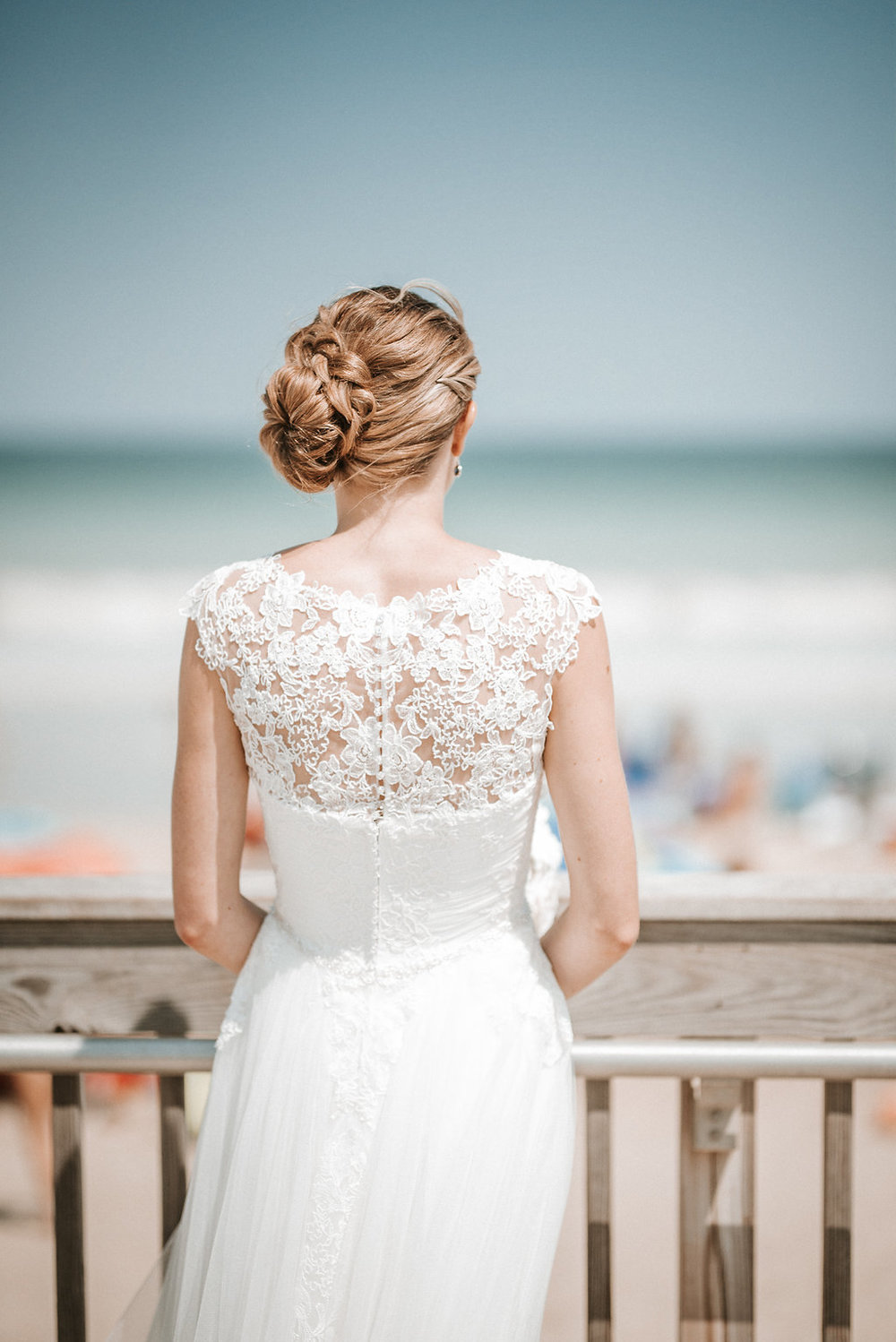 Bride overlooking the beach at Crystal Point Yacht Club