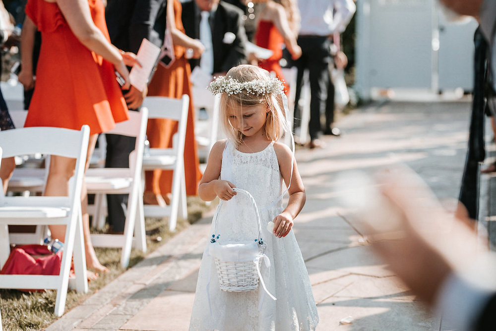 Flower Girl at Wedding Ceremony at Crystal Point Yacht Club