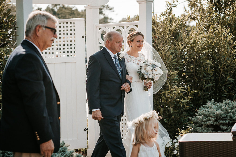 Bride and Father of the Bride walking down the Aisle at Crystal Point Yacht Club