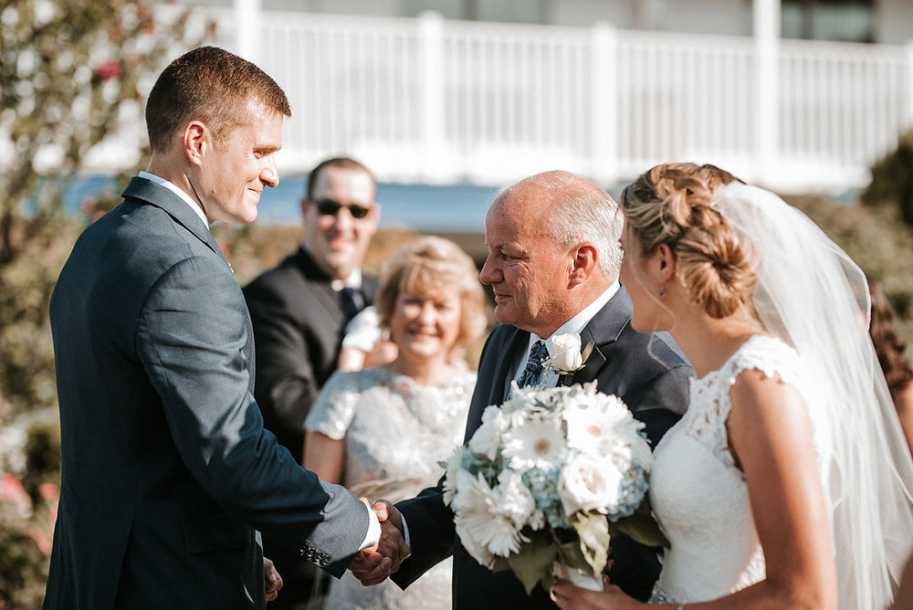 father of the bride giving daughter away at Crystal Point Yacht Club