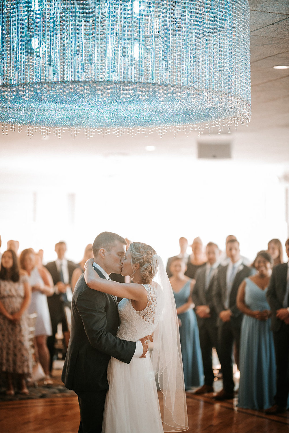 bride and groom dancing at crystal point yacht club