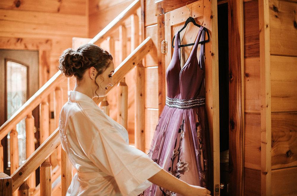 Bride looking at her wedding dress at The Pavilion Shenandoah Woods