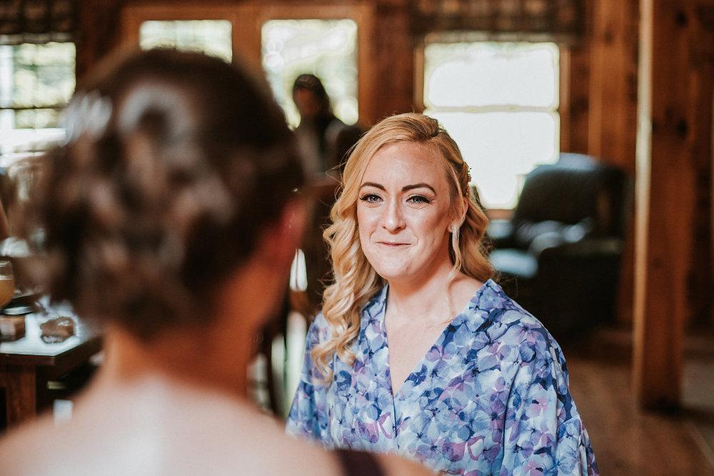 Maid of Honor looking at Bride at The Pavilion Shenandoah Woods