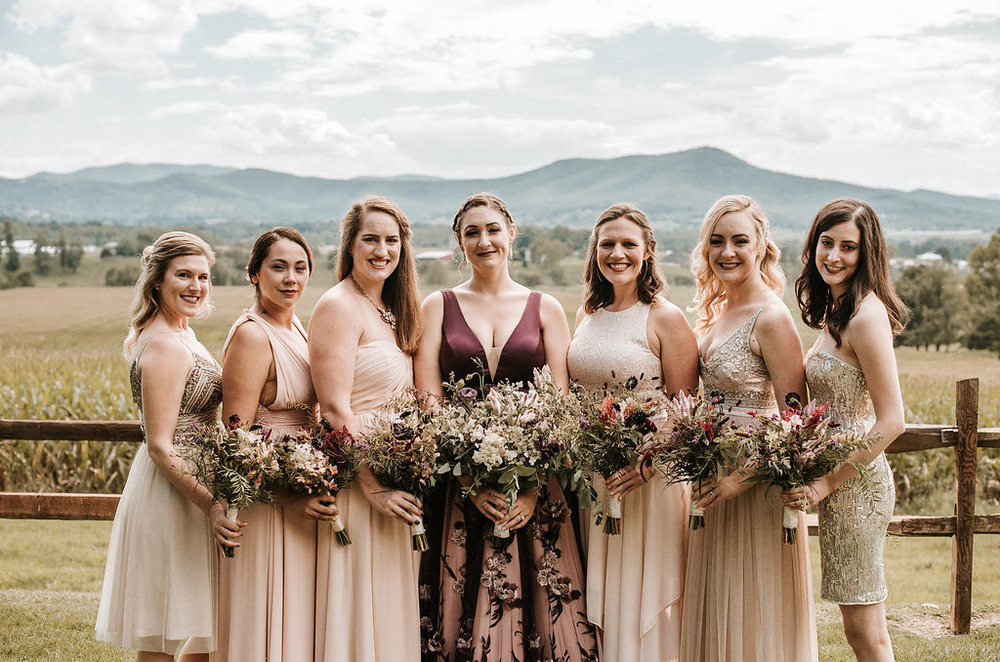 Bride and Bridesmaids Smiling at The Pavilion Shenandoah Woods