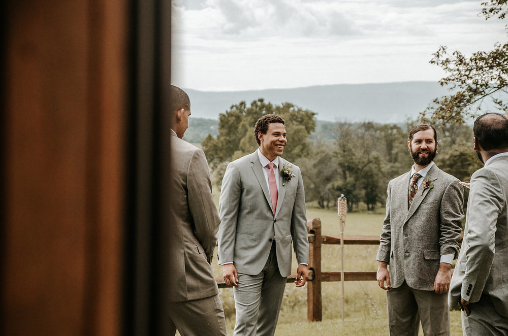 Groom and Groomsmen laughing at The Pavilion Shenandoah Woods