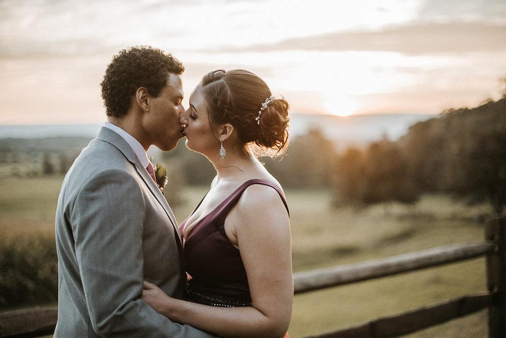 Bride and Groom kissing at The Pavilion Shenandoah Woods