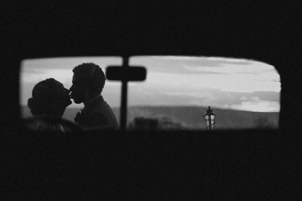 bride and groom kissing in black and white at The Pavilion Shenandoah Woods